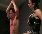 BDSM XXX Slave boy in metal stocks as he receives anal attention from xxx boy boy kb